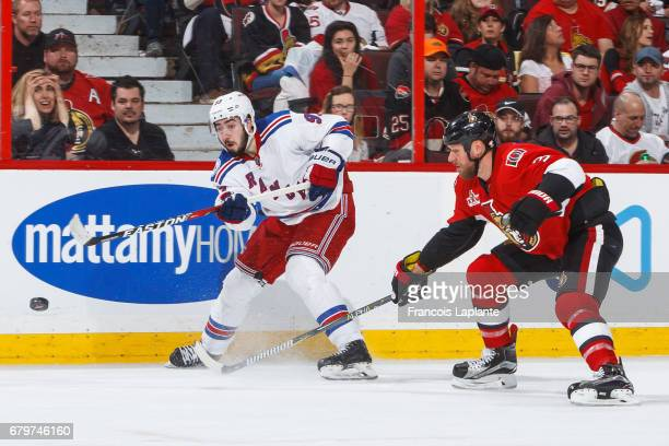 Mika Zibanejad of the New York Rangers shoots the puck against Marc Methot of the Ottawa Senators in Game Five of the Eastern Conference Second Round...