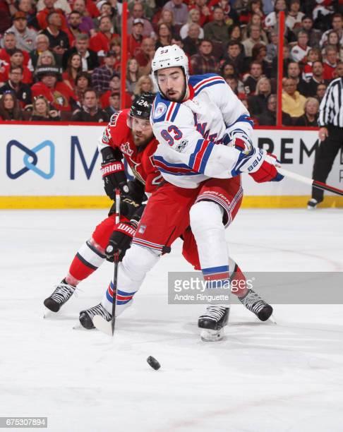 Mika Zibanejad of the New York Rangers skates against Viktor Stalberg of the Ottawa Senators in Game Two of the Eastern Conference Second Round...