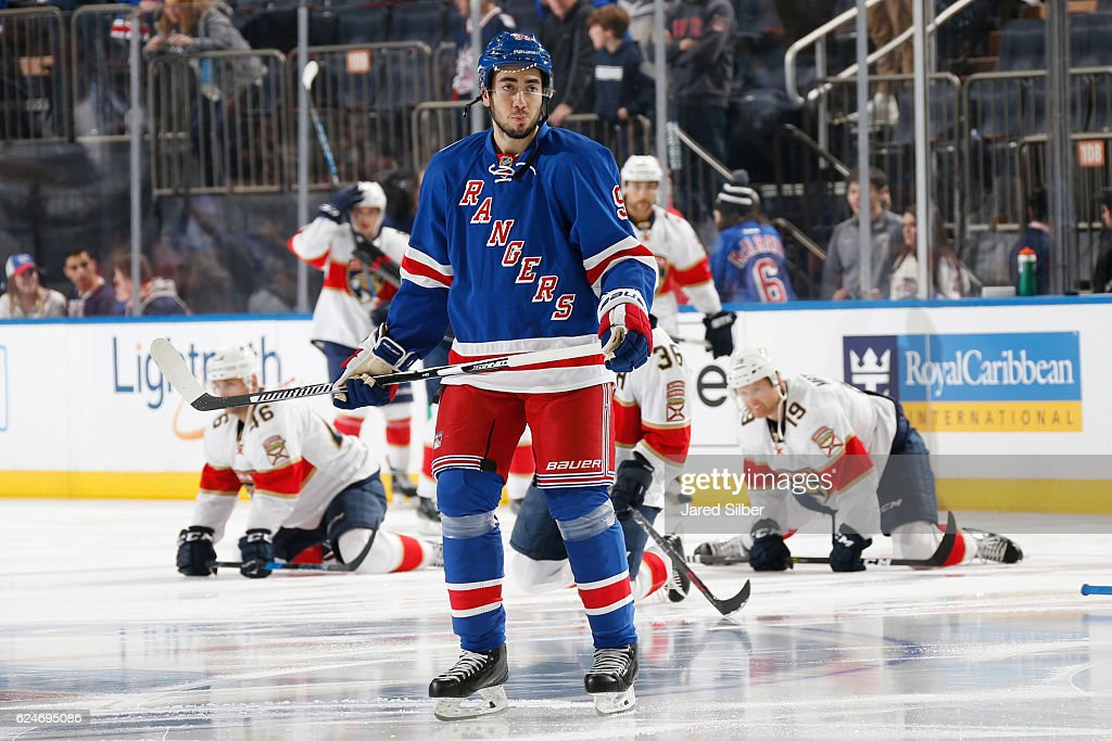 a6877f2f ... Jersey Devils goalie Cory Mika Zibanejad 93 of the New York Rangers  skates during pregame warmups before the game ...