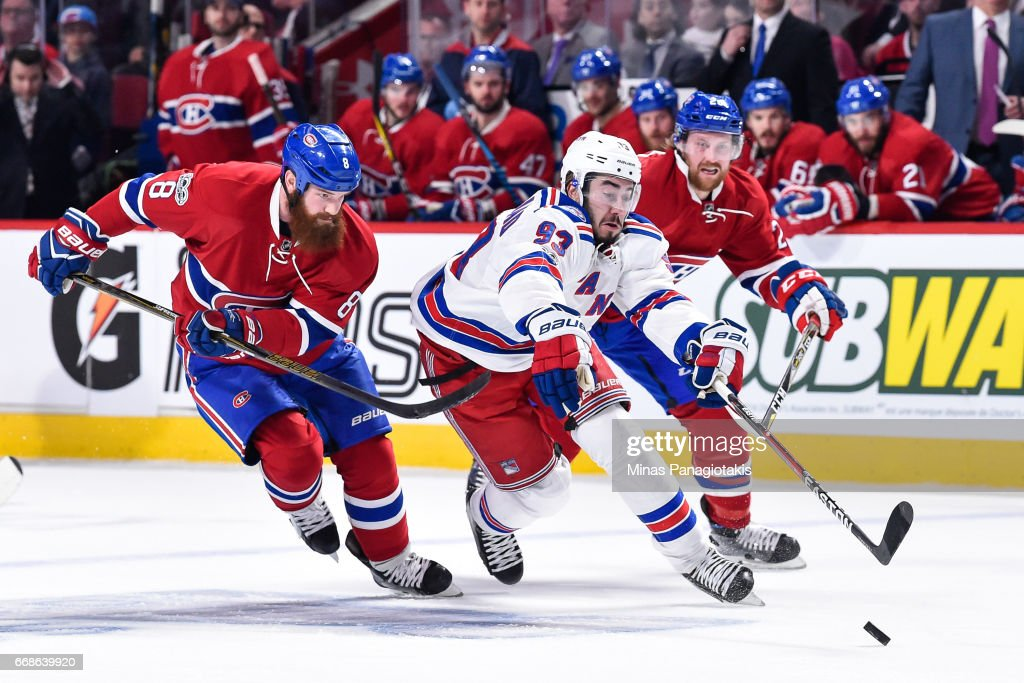 Mika Zibanejad #93 of the New York Rangers skates the puck against Jordie Benn #8 of the Montreal Canadiens in Game Two of the Eastern Conference First Round during the 2017 NHL Stanley Cup Playoffs at the Bell Centre on April 14, 2017 in Montreal, Quebec, Canada.