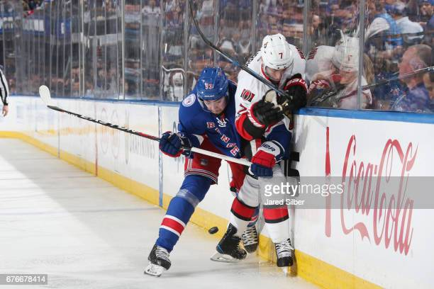 Mika Zibanejad of the New York Rangers throws a hit against Kyle Turris of the Ottawa Senators in Game Three of the Eastern Conference Second Round...