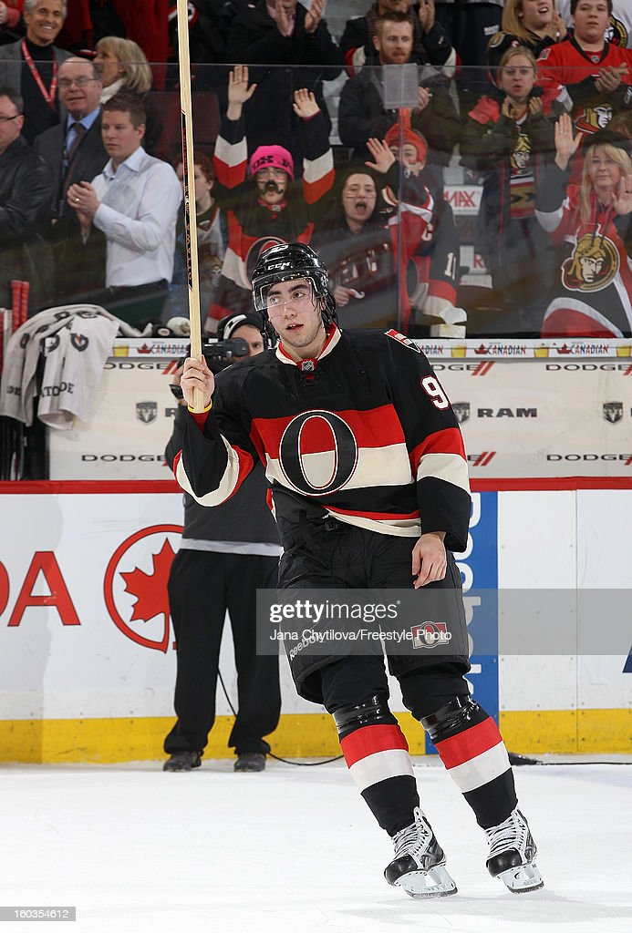 <a gi-track='captionPersonalityLinkClicked' href=/galleries/search?phrase=Mika+Zibanejad&family=editorial&specificpeople=7832310 ng-click='$event.stopPropagation()'>Mika Zibanejad</a> #93 of the Ottawa Senators acknowledges the fans by raising his stick after being named the first start of the game during an NHL game against the Washington Capitals at Scotiabank Place on January 29, 2013 in Ottawa, Ontario, Canada.