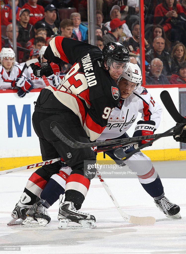 Mika Zibanejad #93 of the Ottawa Senators battles for position against Joey Crabb #15 of the Washington Capitals during an NHL game at Scotiabank Place on January 29, 2013 in Ottawa, Ontario, Canada.