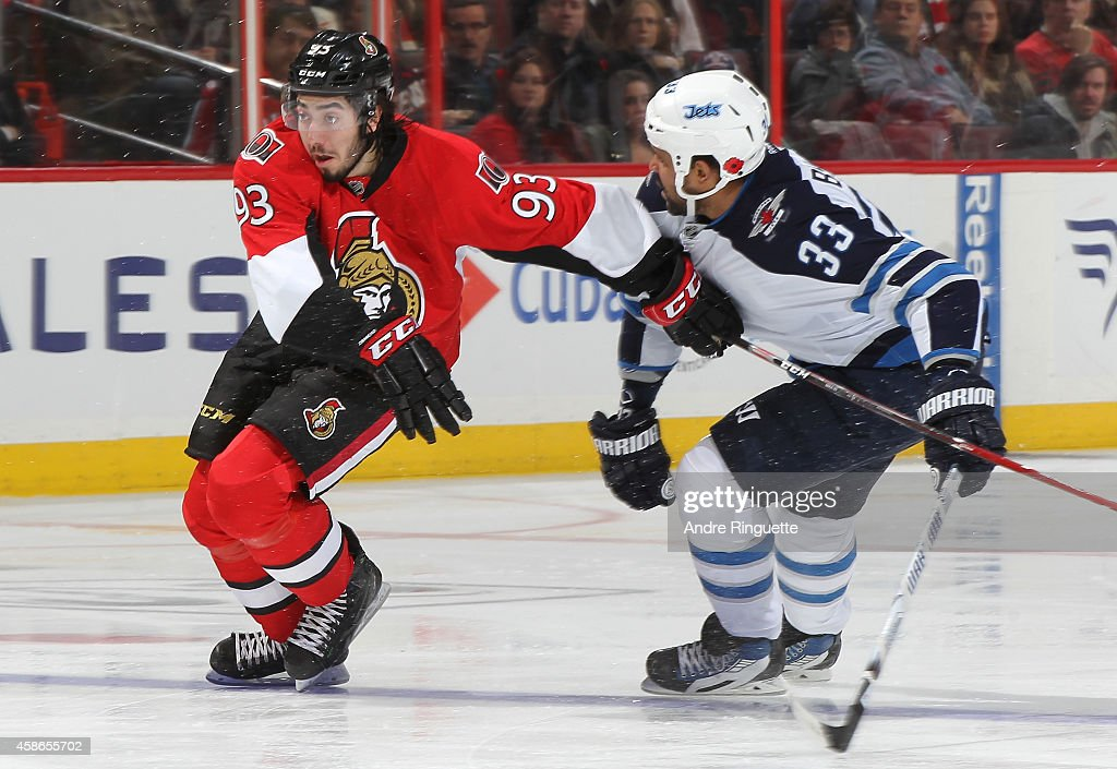Mika Zibanejad #93 of the Ottawa Senators battles for position against Dustin Byfuglien #33 of the Winnipeg Jets at Canadian Tire Centre on November 8, 2014 in Ottawa, Ontario, Canada.