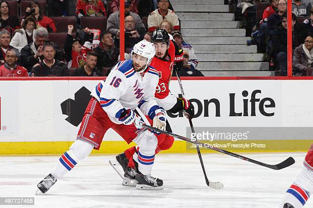 Mika Zibanejad of the Ottawa Senators battles for position against Derick Brassard of the New York Rangers during an NHL game at Canadian Tire Centre...