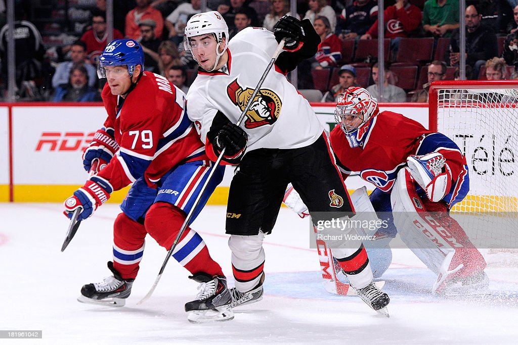 <a gi-track='captionPersonalityLinkClicked' href=/galleries/search?phrase=Mika+Zibanejad&family=editorial&specificpeople=7832310 ng-click='$event.stopPropagation()'>Mika Zibanejad</a> #93 of the Ottawa Senators battles for position with <a gi-track='captionPersonalityLinkClicked' href=/galleries/search?phrase=Andrei+Markov&family=editorial&specificpeople=204528 ng-click='$event.stopPropagation()'>Andrei Markov</a> #79 of the Montreal Canadiens during an NHL preseason game at the Bell Centre on September 26, 2013 in Montreal, Quebec, Canada. The Canadiens defeated the Senators 3-1.