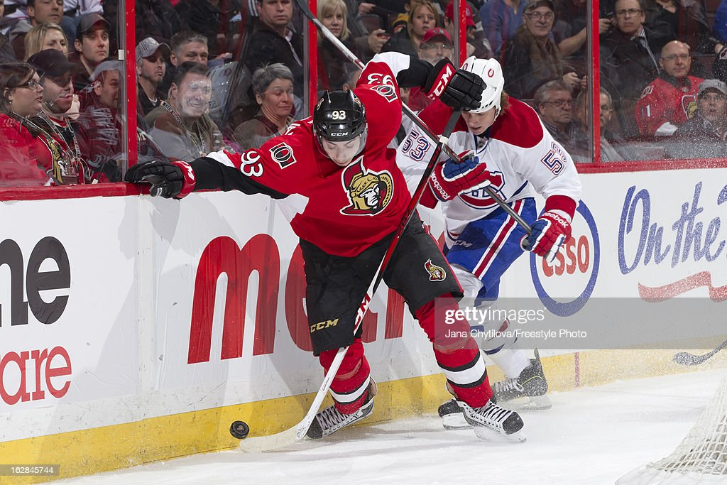 Mika Zibanejad #93 of the Ottawa Senators battles for the puck against Ryan White #53 of the Montreal Canadiens, during an NHL game, at Scotiabank Place on February 25, 2013 in Ottawa, Ontario, Canada.