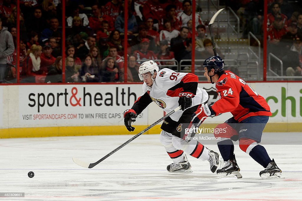 <a gi-track='captionPersonalityLinkClicked' href=/galleries/search?phrase=Mika+Zibanejad&family=editorial&specificpeople=7832310 ng-click='$event.stopPropagation()'>Mika Zibanejad</a> #93 of the Ottawa Senators battles for the puck against <a gi-track='captionPersonalityLinkClicked' href=/galleries/search?phrase=Aaron+Volpatti&family=editorial&specificpeople=7187520 ng-click='$event.stopPropagation()'>Aaron Volpatti</a> #24 of the Washington Capitals in the third period of an NHL game at Verizon Center on November 27, 2013 in Washington, DC.