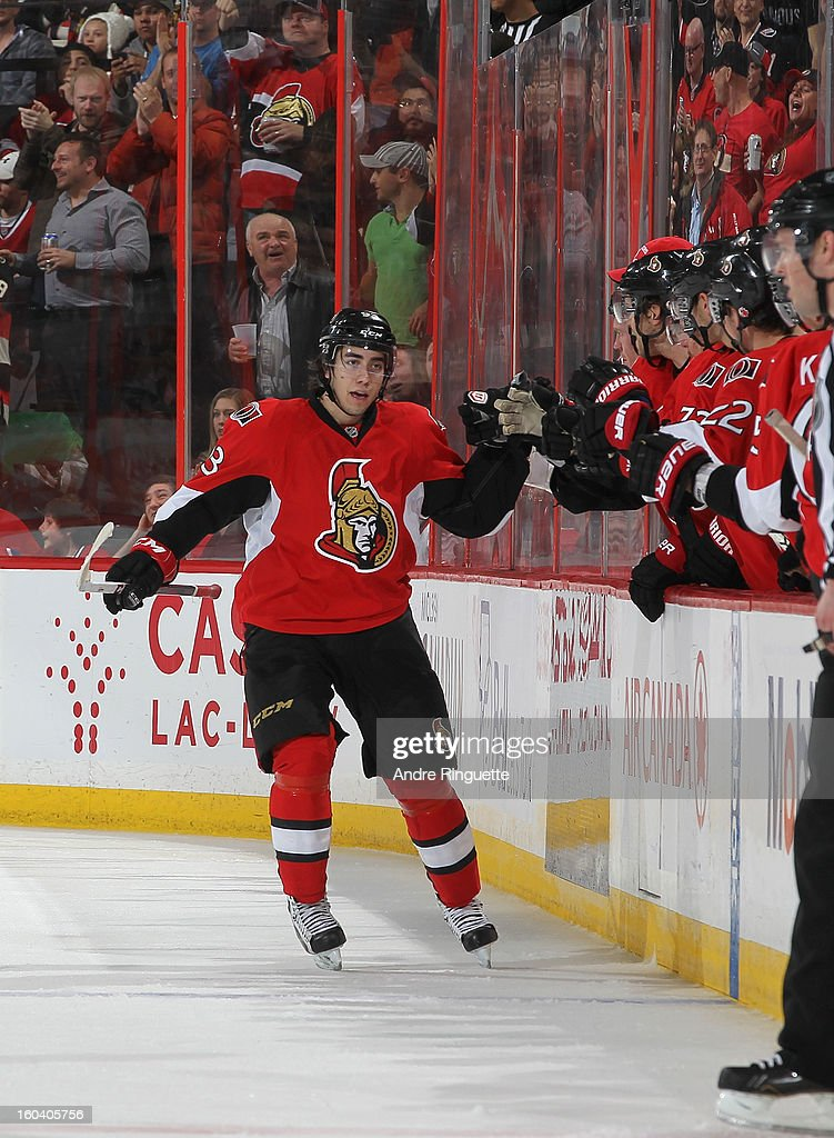 Mika Zibanejad #93 of the Ottawa Senators celebrates his first career NHL goal with teammates at the players' bench during the second period of a game against the Montreal Canadiens on January 30, 2013 at Scotiabank Place in Ottawa, Ontario, Canada.