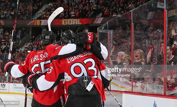 Mika Zibanejad of the Ottawa Senators celebrates his first period goal against the Boston Bruins with teammate Erik Karlsson at Canadian Tire Centre...