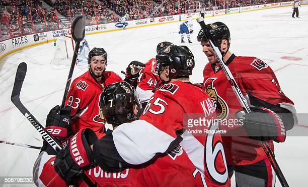Mika Zibanejad of the Ottawa Senators celebrates his first period goal against the Toronto Maple Leafs with teammates Kyle Turris Erik Karlsson and...