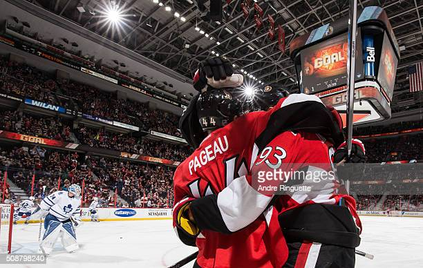 Mika Zibanejad of the Ottawa Senators celebrates his first period goal against the Toronto Maple Leafs with teammate JeanGabriel Pageau at Canadian...
