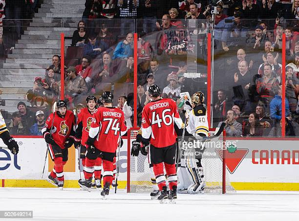 Mika Zibanejad of the Ottawa Senators celebrates his second period goal against the Boston Bruins with team mates Mike Hoffman Mark Borowiecki and...