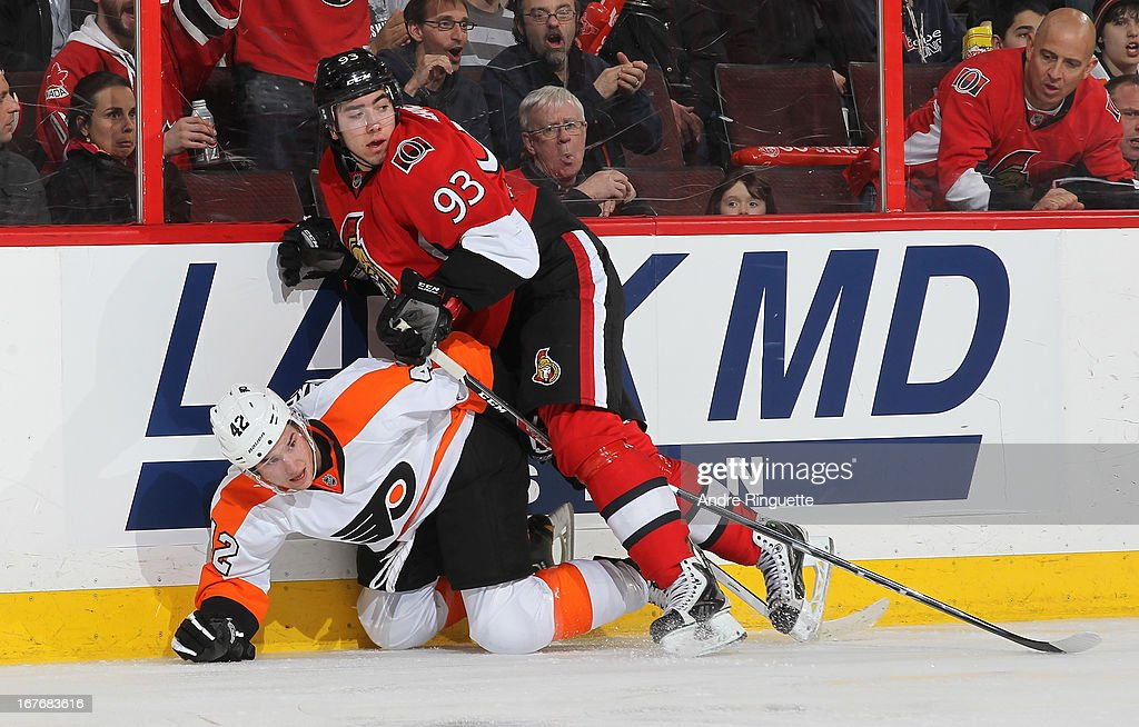 Mika Zibanejad #93 of the Ottawa Senators collides with Jason Akeson #42 of the Philadelphia Flyers along the boards on April 27, 2013 at Scotiabank Place in Ottawa, Ontario, Canada.