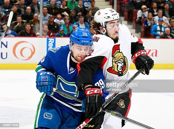 Mika Zibanejad of the Ottawa Senators gets his elbow into the face of Brandon Defazio of the Vancouver Canucks during their NHL game at Rogers Arena...
