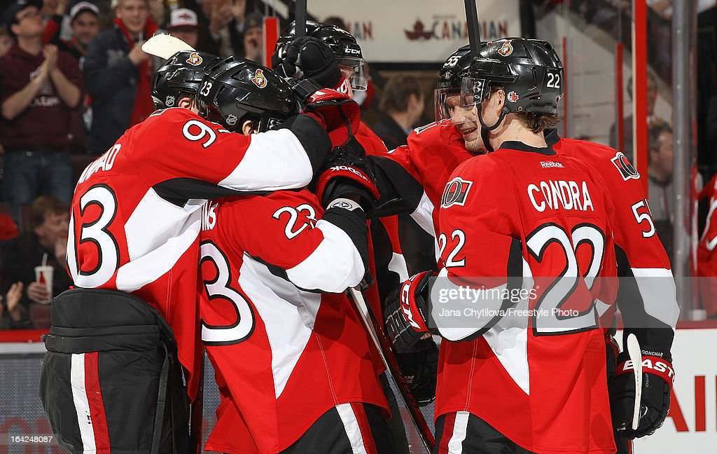 Mika Zibanejad #93 of the Ottawa Senators hugs team mate Kaspars Daugavins #23 after he scored a second period goal, during an NHL game against the Boston Bruins, at Scotiabank Place, on March 21, 2013 in Ottawa, Ontario, Canada.
