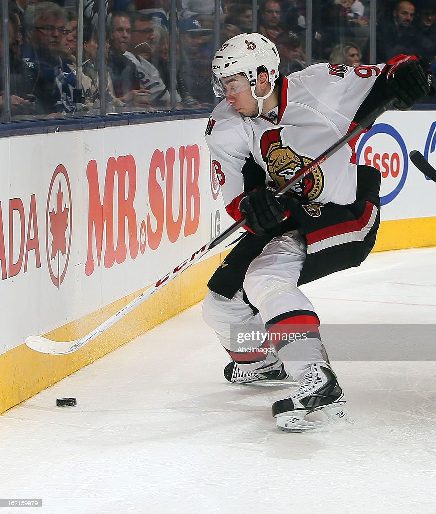 Mika Zibanejad #93 of the Ottawa Senators is looking for an injury during NHL action at the Air Canada Centre against the Toronto Maple Leafs February 16, 2013 in Toronto, Ontario, Canada.