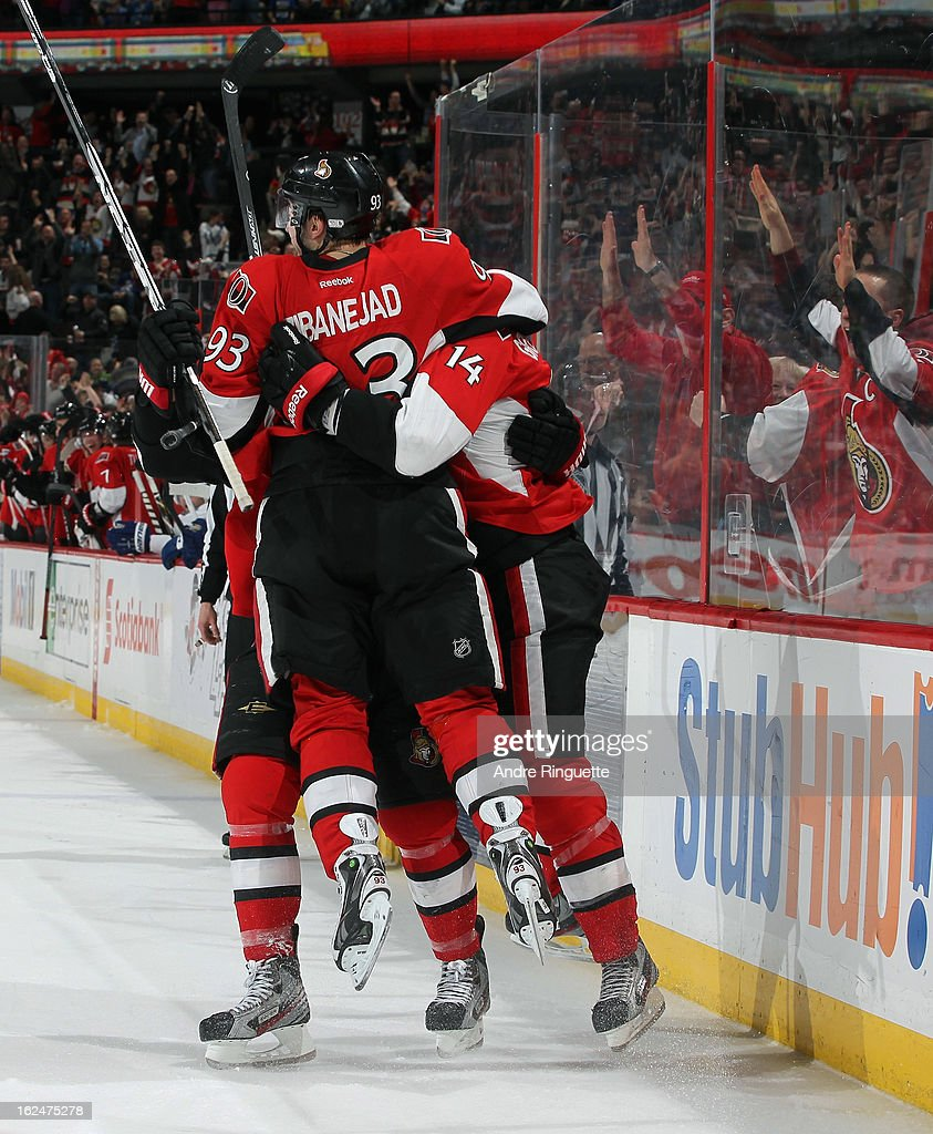 Mika Zibanejad #93 of the Ottawa Senators jumps up into the arms of teammate Colin Greening #14 to celebrate the game-winning goal against the Toronto Maple Leafs in the last minute of play on February 23, 2013 at Scotiabank Place in Ottawa, Ontario, Canada.