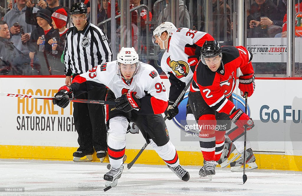 Mika Zibanejad #93 of the Ottawa Senators pursues the puck against Marek Zidlicky #2 of the New Jersey Devils at the Prudential Center on April 12, 2013 in Newark, New Jersey.