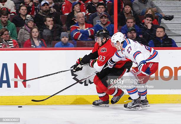 Mika Zibanejad of the Ottawa Senators races for the puck against Ryan McDonagh of the New York Rangers during an NHL game at Canadian Tire Centre on...
