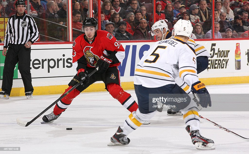 Mika Zibanejad #93 of the Ottawa Senators shoots the puck against Chad Ruhwedel #5 of the Buffalo Sabres during an NHL game at Canadian Tire Centre on February 6, 2014 in Ottawa, Ontario, Canada.