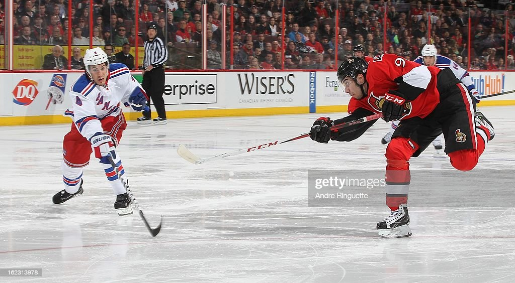 Mika Zibanejad #93 of the Ottawa Senators shoots the puck against Michael Del Zotto #4 of the New York Rangers on February 21, 2013 at Scotiabank Place in Ottawa, Ontario, Canada.