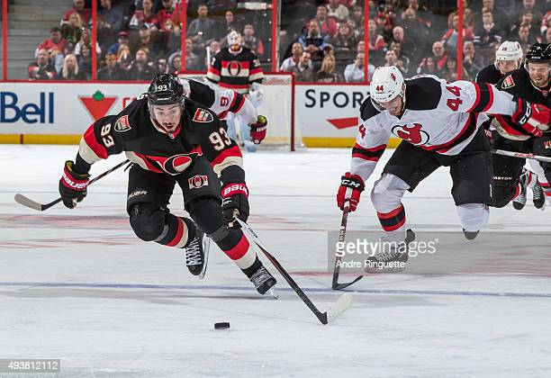 Mika Zibanejad of the Ottawa Senators skates up ice with the puck on a shorthanded breakaway against Eric Gelinas of the New Jersey Devils at...