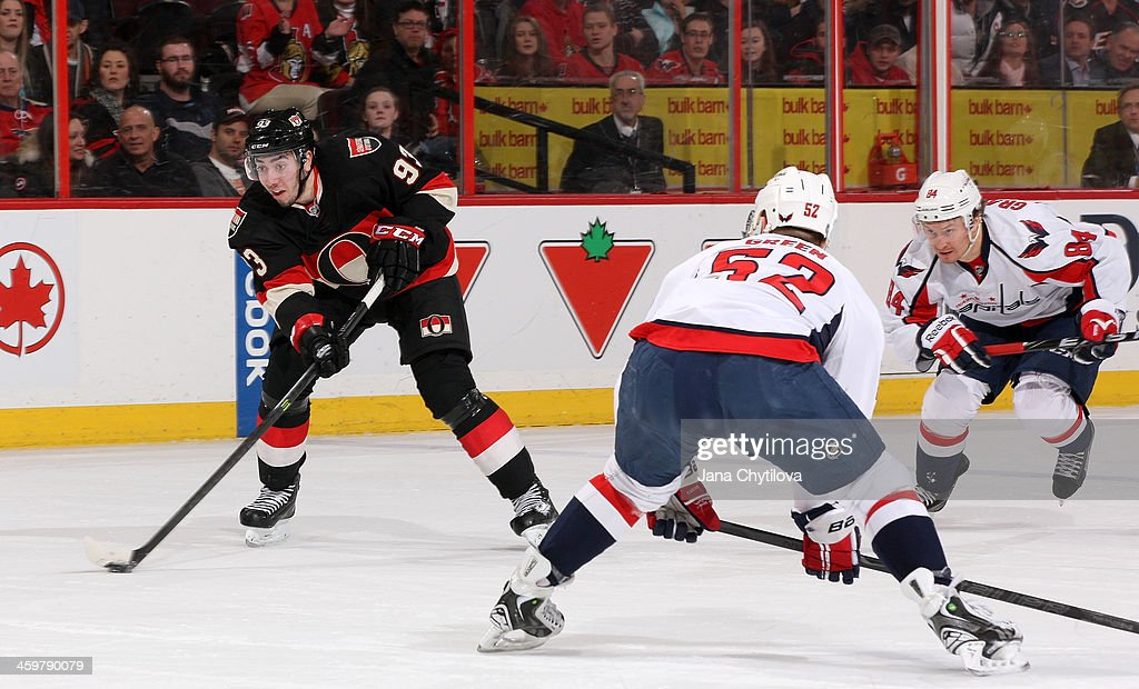 <a gi-track='captionPersonalityLinkClicked' href=/galleries/search?phrase=Mika+Zibanejad&family=editorial&specificpeople=7832310 ng-click='$event.stopPropagation()'>Mika Zibanejad</a> #93 of the Ottawa Senators skates with the puck on a breakaway attempt against Mike Green #52 of the Washington Capitals during an NHL game at Canadian Tire Centre on December 30, 2013 in Ottawa, Ontario, Canada.