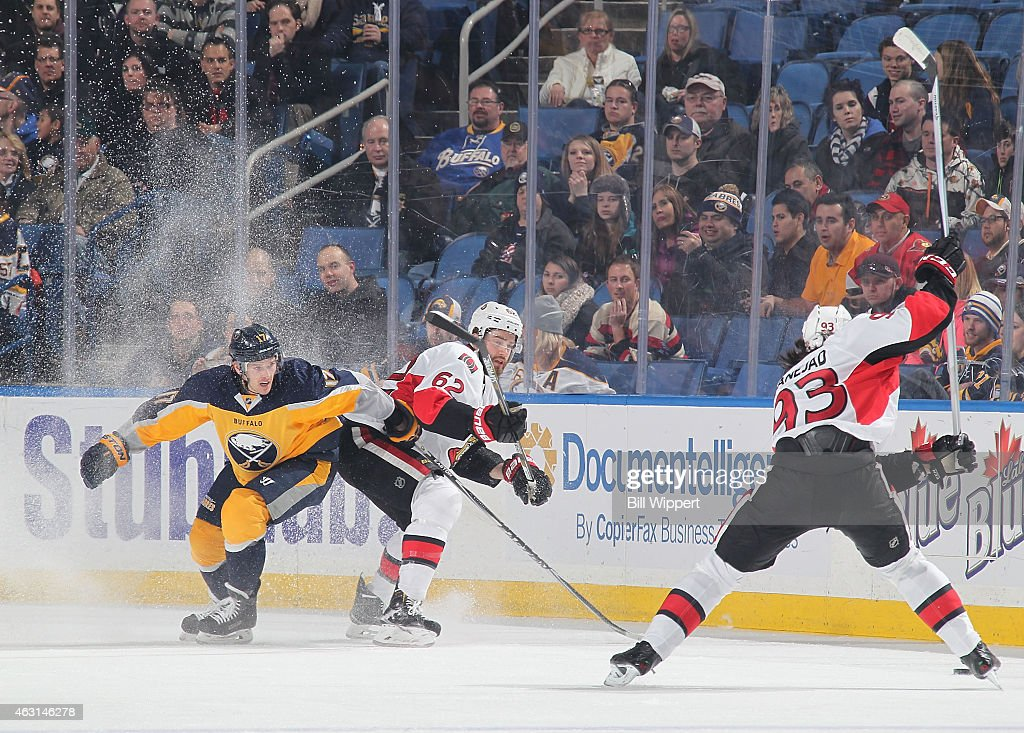 <a gi-track='captionPersonalityLinkClicked' href=/galleries/search?phrase=Mika+Zibanejad&family=editorial&specificpeople=7832310 ng-click='$event.stopPropagation()'>Mika Zibanejad</a> #93 of the Ottawa Senators winds up for a slapshot while teammate <a gi-track='captionPersonalityLinkClicked' href=/galleries/search?phrase=Eric+Gryba&family=editorial&specificpeople=570539 ng-click='$event.stopPropagation()'>Eric Gryba</a> #62 and <a gi-track='captionPersonalityLinkClicked' href=/galleries/search?phrase=Torrey+Mitchell&family=editorial&specificpeople=4504539 ng-click='$event.stopPropagation()'>Torrey Mitchell</a> #17 of the Buffalo Sabres react on February 10, 2015 at the First Niagara Center in Buffalo, New York.