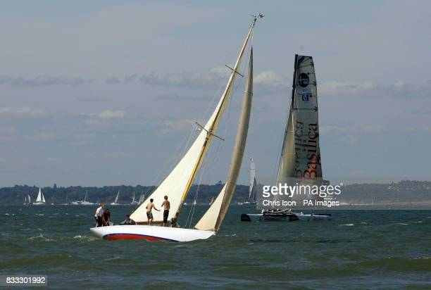 Mikado sails past an Extreme 40 catamaran as she arrives for the Skandia Cowes Week Regatta Isle of Wight