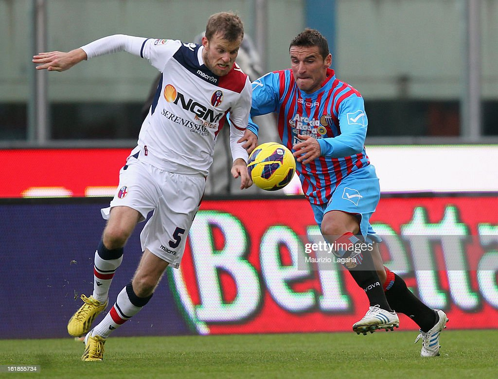 Mikael Antonsson of Bologna (L) and Gonzalo Bergessio of Catania compete for the ball during the Serie A match between Calcio Catania and Bologna FC at Stadio Angelo Massimino on February 17, 2013 in Catania, Italy.