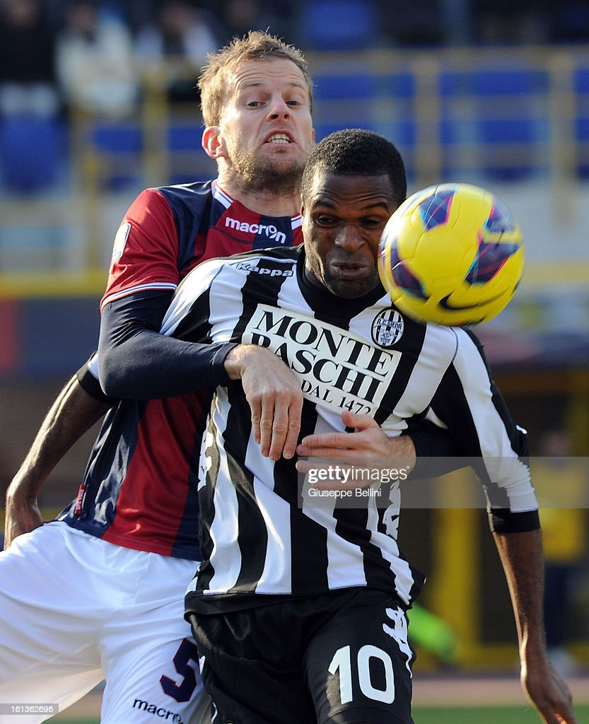 Mikael Antonsson of Bologna and Innocent Emeghara of Siena in action during the Serie A match between Bologna FC and AC Siena at Stadio Renato Dall'Ara on February 10, 2013 in Bologna, Italy.