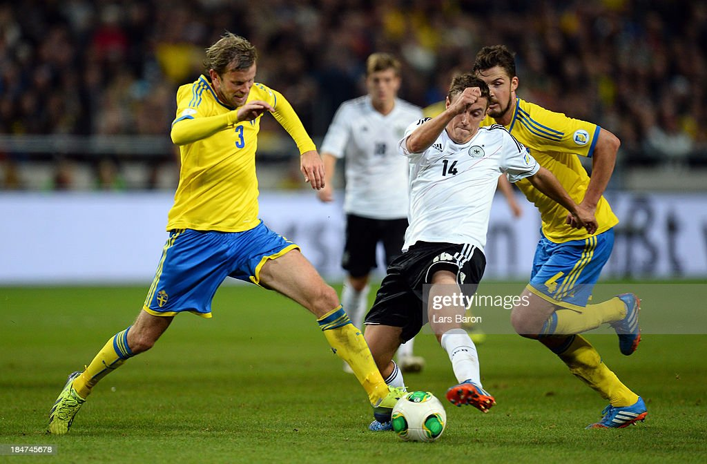 Mikael Antonsson of Sweden challenes <a gi-track='captionPersonalityLinkClicked' href=/galleries/search?phrase=Max+Kruse&family=editorial&specificpeople=3945507 ng-click='$event.stopPropagation()'>Max Kruse</a> of Germany during the FIFA 2014 World Cup Qualifying Group C match between Sweden and Germany at Friends Arena Solna on October 15, 2013 in Stockholm, Sweden.