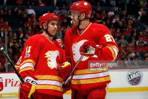 Mikael Backlund and Dougie Hamilton of the Calgary Flames skate against the Philadelphia Flyers during an NHL game on February 15 2017 at the...