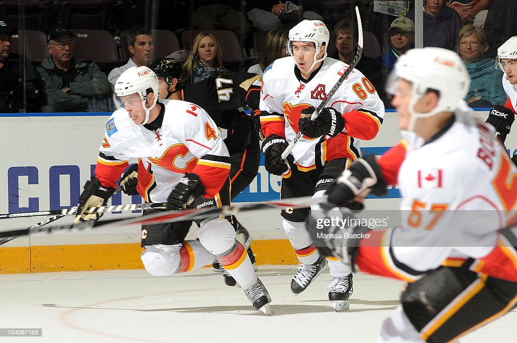 Mikael Backlund #60 and Jon Rheault #47 of the Calgary Flames skates on the ice against the Anaheim Ducks during game 2 of the Young Stars Tournament on September 13, 2010 in Penticton, Canada.