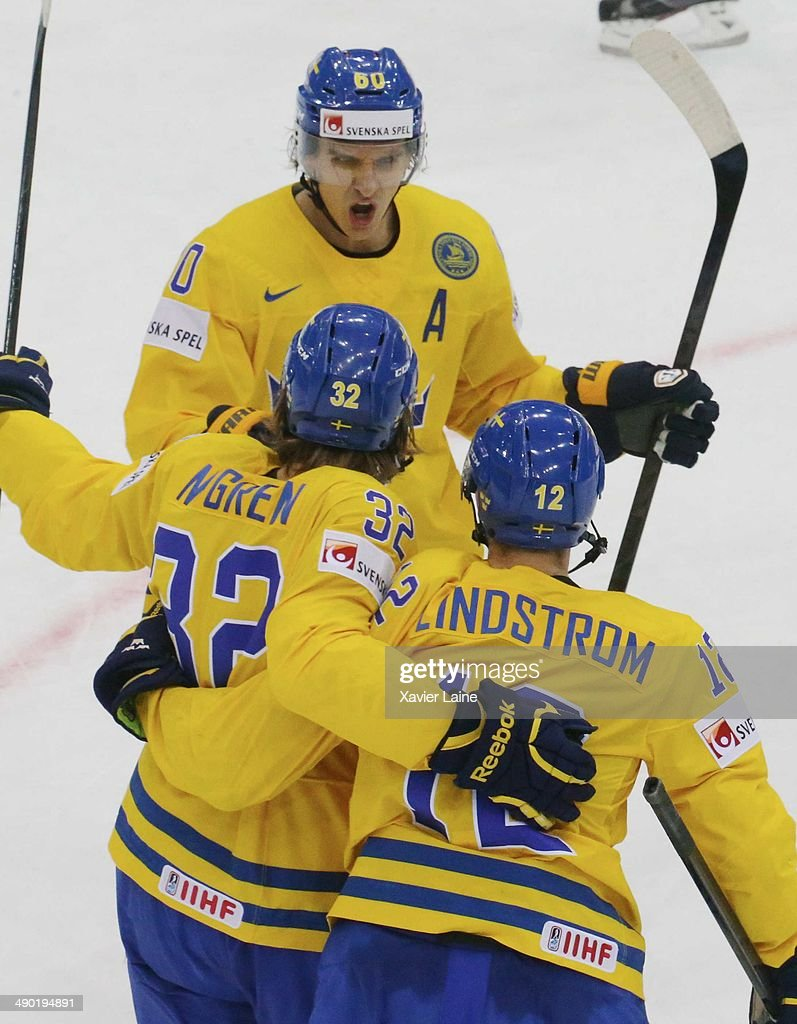 Mikael Backlund, Magnus Nygren and joakim Lindstrom of Sweden celebrate his goal during the 2014 IIHF World Championship between Sweden and Norway at Chizhovka arena on May 13, 2014 in Minsk, Belarus.