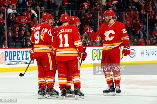 Mikael Backlund Matthew Tkachuk and teammates of the Calgary Flames celebrate a win against the Philadelphia Flyers during an NHL game on February 15...