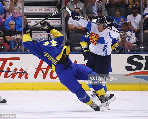 Mikael Backlund of Team Sweden is hit by Sami Lepisto of Team Finland during the third period during the World Cup of Hockey tournament at the Air...