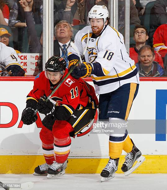Mikael Backlund of the Calgary Flames battles against James Neal of the Nashville Predators at Scotiabank Saddledome on March 9 2016 in Calgary...