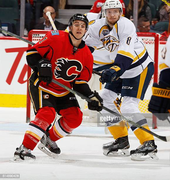 Mikael Backlund of the Calgary Flames battles against Petter Granberg of the Nashville Predators at Scotiabank Saddledome on March 9 2016 in Calgary...