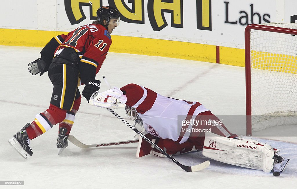 <a gi-track='captionPersonalityLinkClicked' href=/galleries/search?phrase=Mikael+Backlund&family=editorial&specificpeople=4324942 ng-click='$event.stopPropagation()'>Mikael Backlund</a> #11 of the Calgary Flames can't get the puck past <a gi-track='captionPersonalityLinkClicked' href=/galleries/search?phrase=Jonas+Gustavsson&family=editorial&specificpeople=886789 ng-click='$event.stopPropagation()'>Jonas Gustavsson</a> #50 of the Detroit Red Wings on a penalty shot during third period NHL action on March 13, 2013 at the Scotiabank Saddledome in Calgary, Alberta, Canada. Calgary Flames defeated the Detroit Red Wings 5 - 2.