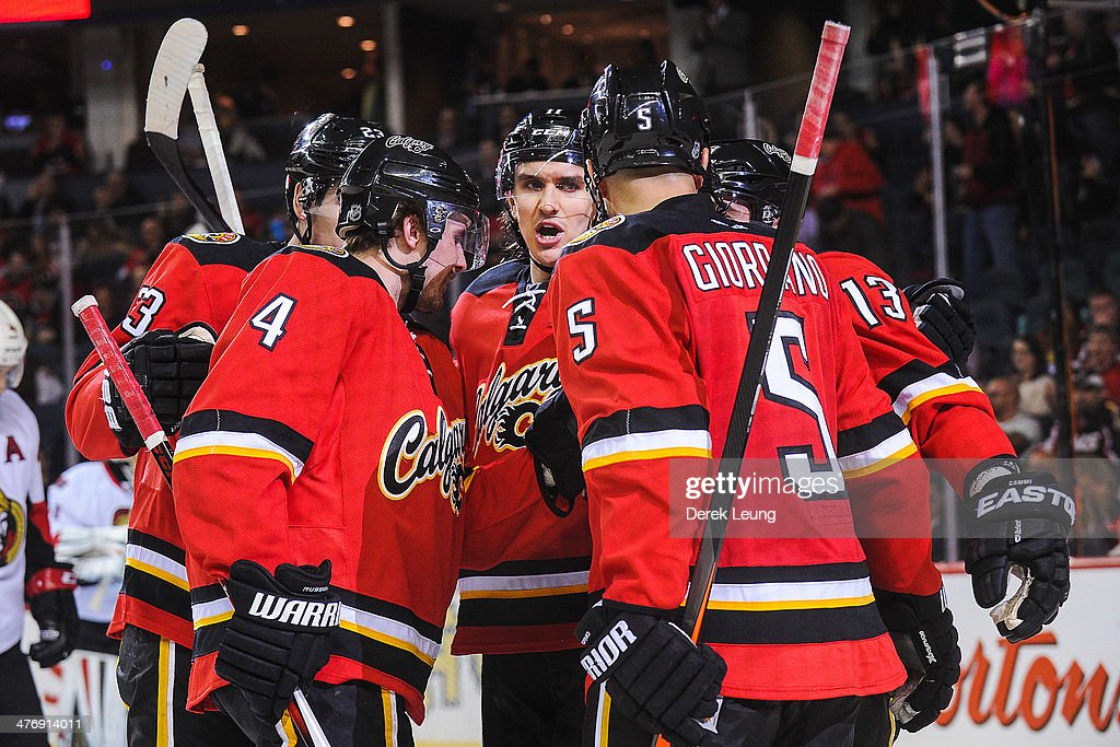 <a gi-track='captionPersonalityLinkClicked' href=/galleries/search?phrase=Mikael+Backlund&family=editorial&specificpeople=4324942 ng-click='$event.stopPropagation()'>Mikael Backlund</a> #11 (C) of the Calgary Flames celebrates the goal of teammate <a gi-track='captionPersonalityLinkClicked' href=/galleries/search?phrase=Mike+Cammalleri&family=editorial&specificpeople=634009 ng-click='$event.stopPropagation()'>Mike Cammalleri</a> #13 (R) against the Ottawa Senators during an NHL game at Scotiabank Saddledome on March 5, 2014 in Calgary, Alberta, Canada. The Flames defeated the Senators 4-1.