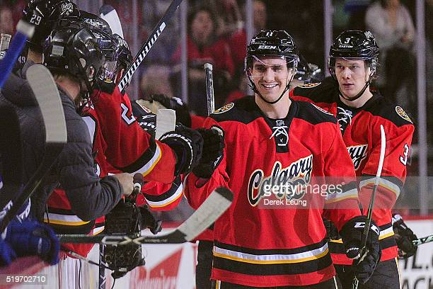 Mikael Backlund of the Calgary Flames celebrates with the bench after scoring against the Vancouver Canucks during an NHL game at Scotiabank...