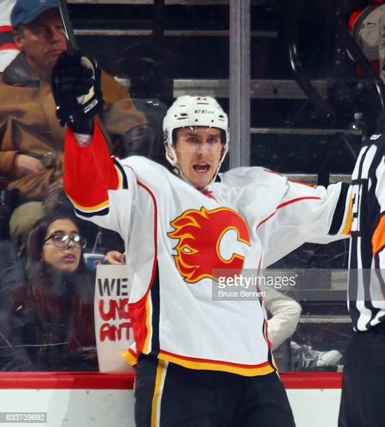 Mikael Backlund of the Calgary Flames celebratse his game winning overtime goal against the New Jersey Devils at the Prudential Center on February 3...