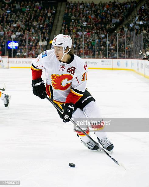 Mikael Backlund of the Calgary Flames controls the puck during the game against the Minnesota Wild on March 3 2014 at Xcel Energy Center in St Paul...