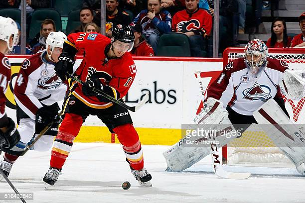Mikael Backlund of the Calgary Flames gets set to shoot the puck against Semyon Varlamov of the Colorado Avalanche during an NHL game at Scotiabank...