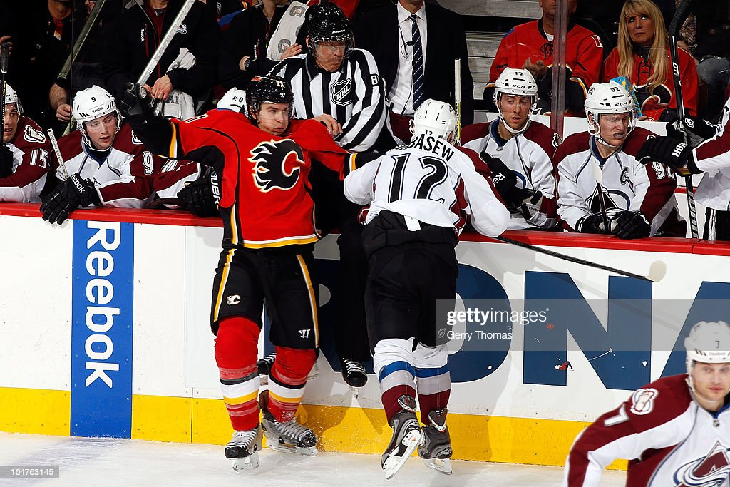 <a gi-track='captionPersonalityLinkClicked' href=/galleries/search?phrase=Mikael+Backlund&family=editorial&specificpeople=4324942 ng-click='$event.stopPropagation()'>Mikael Backlund</a> #11 of the Calgary Flames is checked by <a gi-track='captionPersonalityLinkClicked' href=/galleries/search?phrase=Chuck+Kobasew&family=editorial&specificpeople=208995 ng-click='$event.stopPropagation()'>Chuck Kobasew</a> #12 of the Colorado Avalanche on March 27, 2013 at the Scotiabank Saddledome in Calgary, Alberta, Canada.