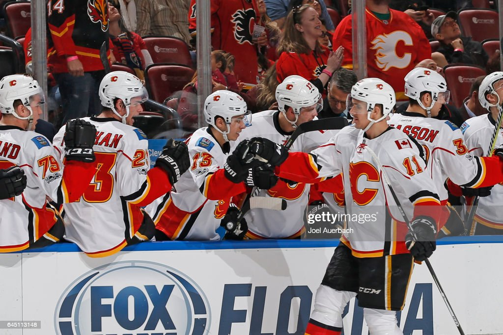 Mikael Backlund #11 of the Calgary Flames is congratulated by teammates after scoring a goal against the Florida Panthers at the BB&T Center on February 24, 2017 in Sunrise, Florida. The Flames defeated the Panthers 4-2.