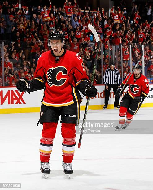Mikael Backlund of the Calgary Flames lets out a roar after a goal against the San Jose Sharks at Scotiabank Saddledome on December 8 2015 in Calgary...