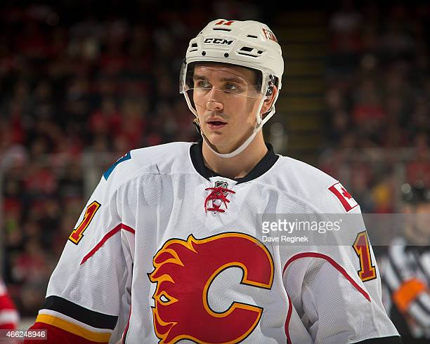 Mikael Backlund of the Calgary Flames looks down the ice during a NHL game against the Detroit Red Wings on March 6 2015 at Joe Louis Arena in...